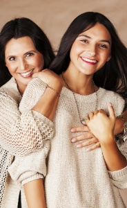 Mother and daughter smiling after restorative dentistry appointment