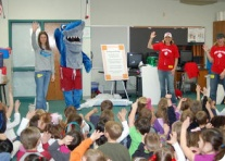Shark mascott and team at kids education event