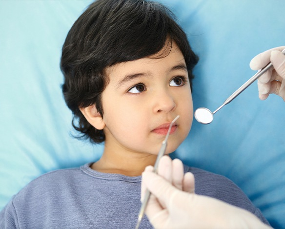 Relaxed child receiving treatment under nitrous oxide dental sedation