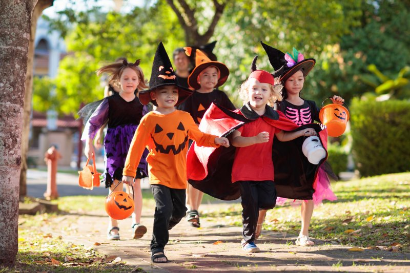 a group of young kids trick-or-treating on Halloween